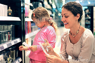Mother and daughter choose perfume in perfume shop