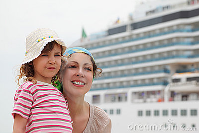 Mother and daughter, cruise ship on background