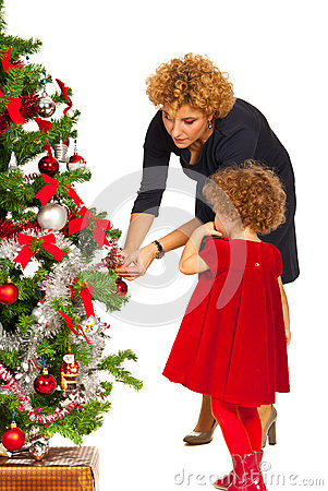 Mother and daughter decorate Xmas tree