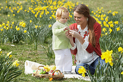 Mother And Daughter With Decorated Easter Eggs