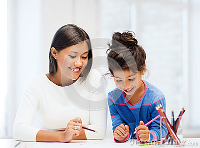 Mother and daughter drawing Stock Photo