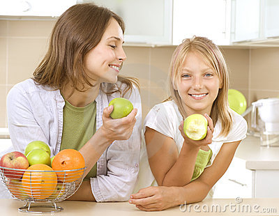 Mother with Daughter eating Apples