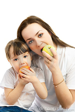 Mother and daughter eating apples