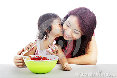 Mother and Daughter eating fruit salad