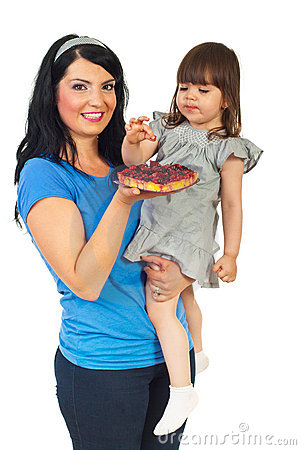 Mother with daughter eating fruit tart