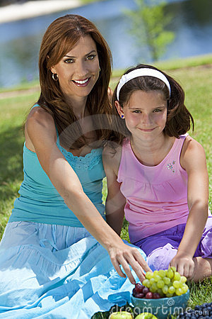 Free Mother & Daughter Eating Healthy Fruit Picnic Royalty Free Stock Image - 16280736