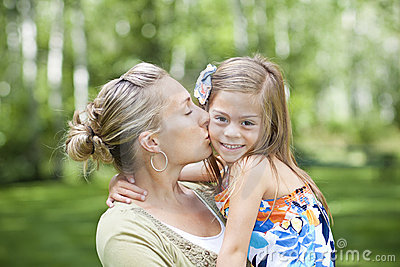 A mother and daughter embracing