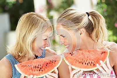 Mother And Daughter Enjoyin Water Melon