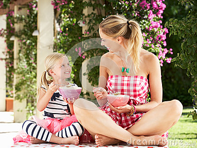 Mother And Daughter Enjoying Breakfast Together