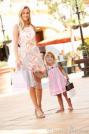 Mother And Daughter Enjoying Shopping Trip