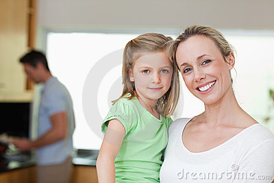 Mother And Daughter With Father In The Background Stock Photos - Image: 22661323