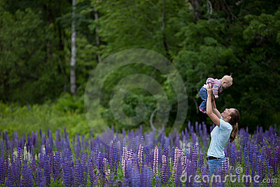 Mother & Daughter in Field of Lupine Flowers