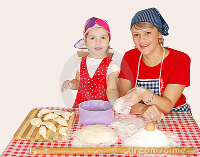 Mother and daughter with flour