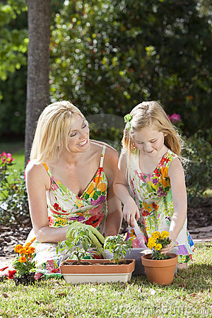 Mother & Daughter Gardening Planting Flowers