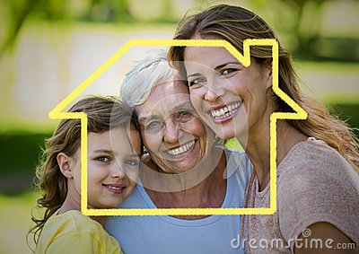 Mother, daughter and grandmother smiling together in the park with house outline Stock Photo