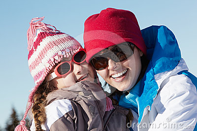 Mother And Daughter Having Fun On Ski Holiday