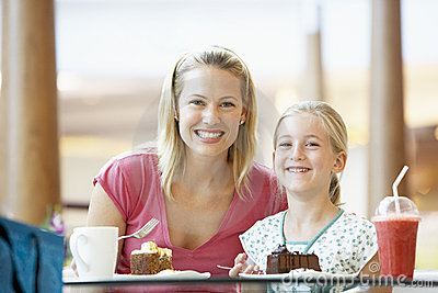 Mother And Daughter Having Lunch Together At Cafe