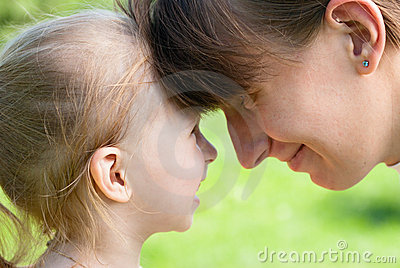 Mother and daughter hugged each other foreheads