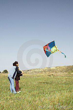 Mother and daughter with kite