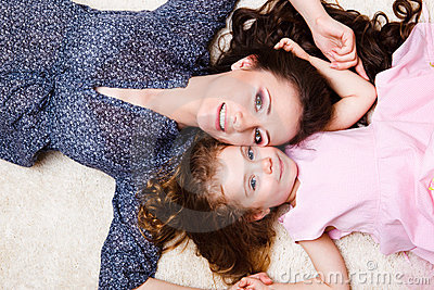 Mother and daughter laying
