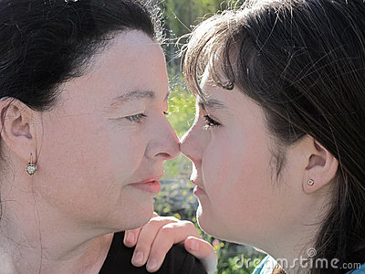 Mother and daughter look with tenderness