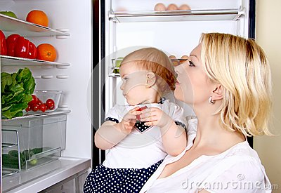 Mother and daughter looking in a refrigerator