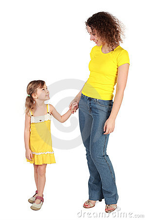 Mother and daughter looking to each other and