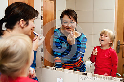 Mother and daughter with mirror