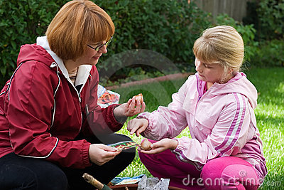 Mother and daughter planting tulips