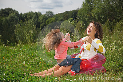 Mother and daughter play in the open air