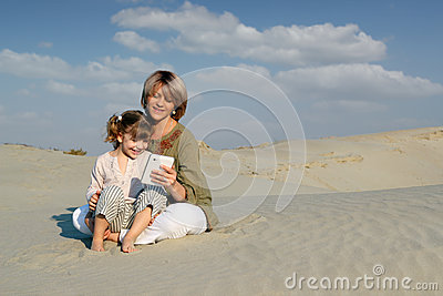 Mother and daughter play with tablet