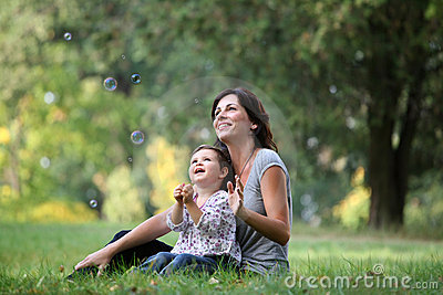 Mother and daughter playing with bubble