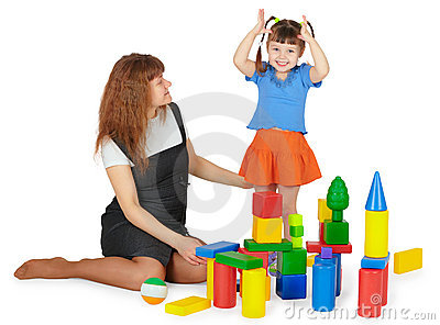 Mother and daughter playing with color blocks