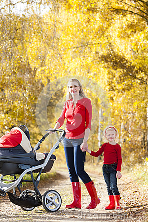 Mother and daughter with a pram