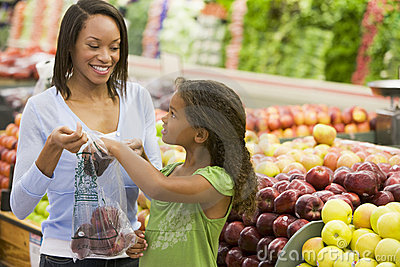 Mother and daughter in produce section