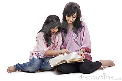 Mother and daughter read a book