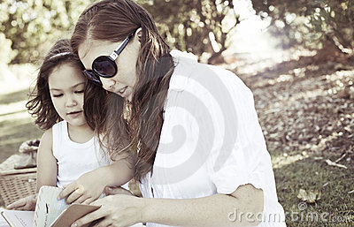 Mother and daughter reading