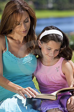Mother and Daughter Reading Book Together Outside