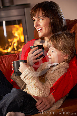 Mother And Daughter Relaxing With Hot Drink