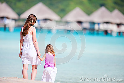 Mother and daughter at resort beach