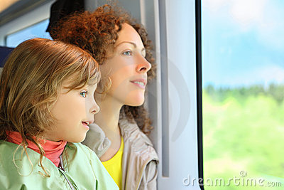 Mother with daughter ride in speed train