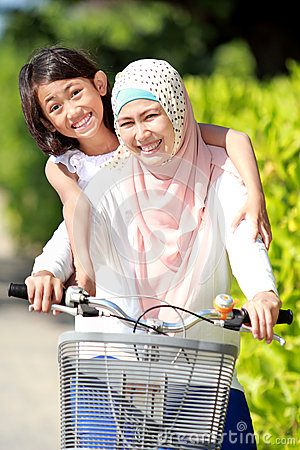 Mother and daughter riding bike