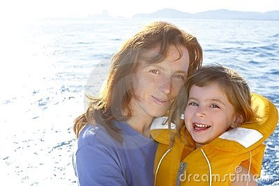 Mother and daughter safety vest backlight sea
