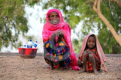 Mother with daughter selling milk Editorial Stock Photo