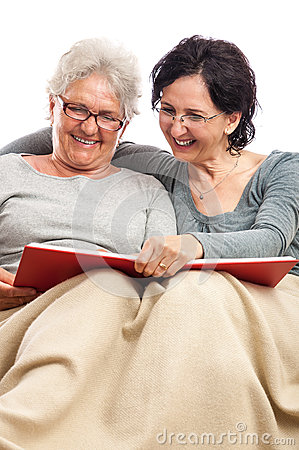 Mother and daughter sharing memories photo album