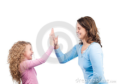 Mother and daughter smiling, clapping their hands
