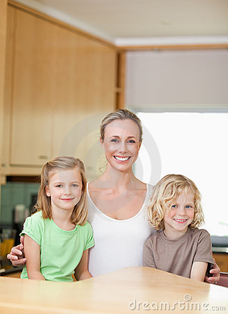 Mother with daughter and son in the kitchen together