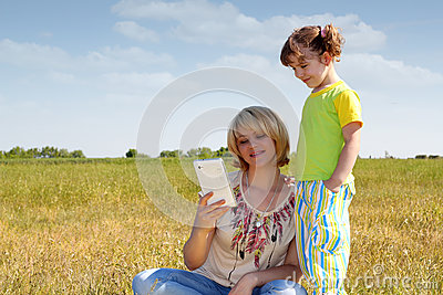 Mother and daughter with tablet