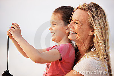 Mother and daughter taking photos