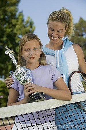Mother and Daughter at Tennis Net holding trophy